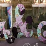 fabric-covered wooden initials