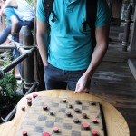 Moseying around Frontierland, we stopped to play checkers. We had to figure out how again.
