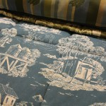 The bed spread print is themed with images of the resort's iconic structures.