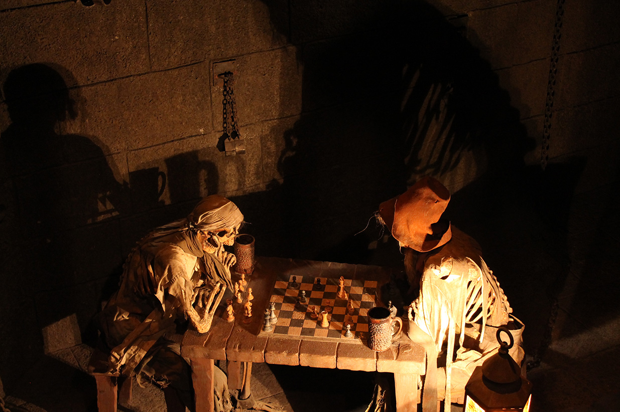 The chess game in Pirates of the Caribbean is rumored to be in stalemate, as if the pirates died playing the game because neither side could move.