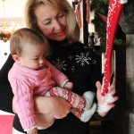 Grandma shows Madeline the stocking she made for her