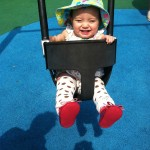 13 months: swing fun at Smith Playground